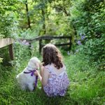 Girl and puppy in the woods